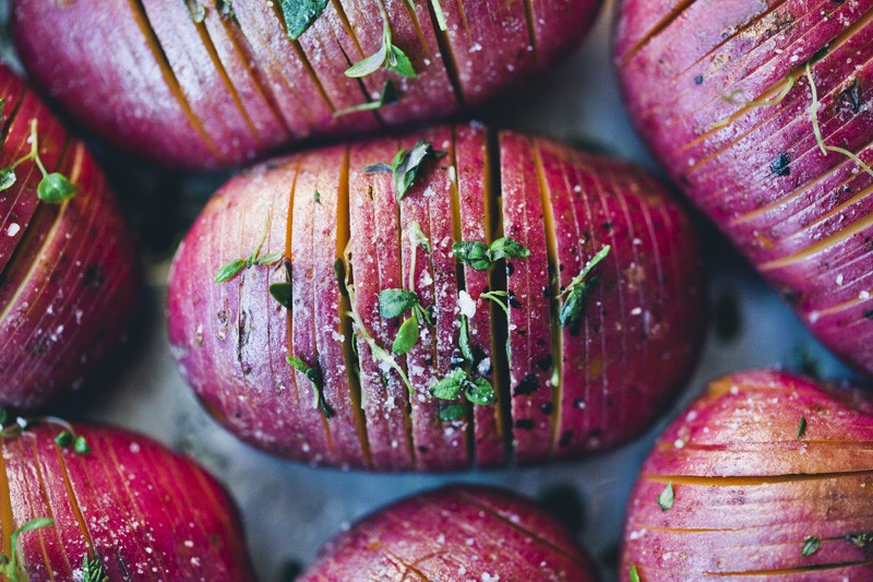 Hasselback Potatoes with Kale & Pesto